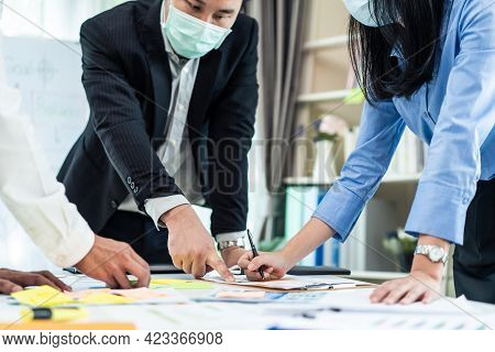 Group Of Business People Wear Mask Due To Covid19, Meeting In Office. Man And Woman Brainstorm And W