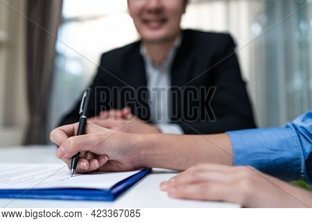 Close Up Hands Of Businesswoman Working In Office, Write On Paperwork And Prepare Document Plan On T