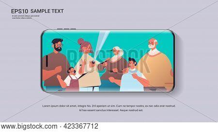 Multigenerational Family Using Selfie Stick Taking Photo On Camera Smartphone Screen