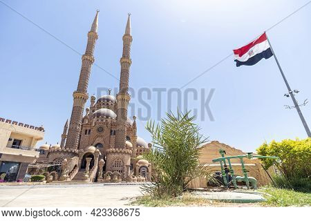 Al Mustafa Mosque In The Old Town Of Sharm El Sheikh. Square Near The Mosque. Flag Of Egypt.