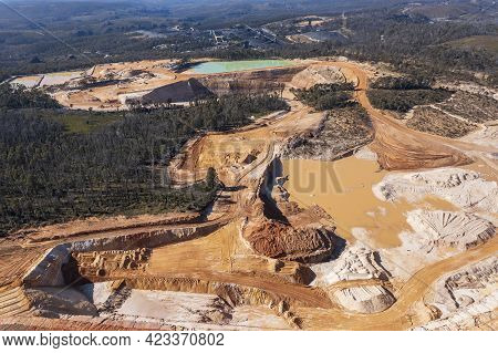 Drone Aerial Photograph Of An Industrial Colliery And Water Reservoirs In A Large Forest