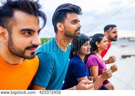 Large Group Of Multi Generation People Running A Race Competition