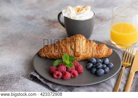 Continental Breakfast, French Croissant, Coffee With Milk, Berries And Orange Juice. Good Morning Co