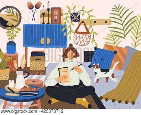 Young Relaxed Woman Writing Letter In Cozy Modern Room At Home. Person Resting Indoors With Cat. Lif