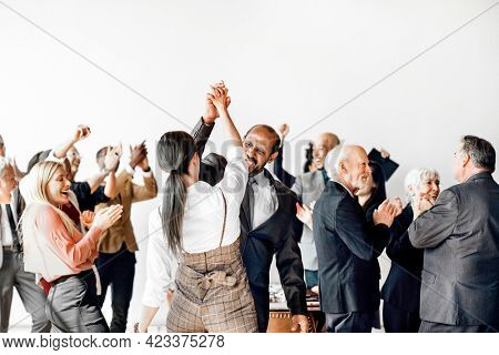 Business people doing a high five