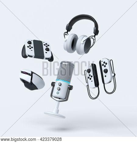 Flying Gamer Gears Like Mouse, Joystick, Headphones, Vr Glasses, Microphone On White Table Backgroun