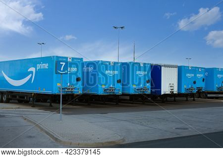 Poland, Sady - May 05, 2021: Amazon Trailers Parked In The Parking Lot Next To The Warehouses. Logis
