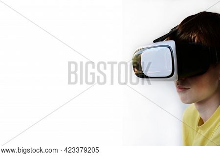Portrait Of A Young Man Wearing Virtual Reality Glasses. The Concept Of Technology, Science, Innovat