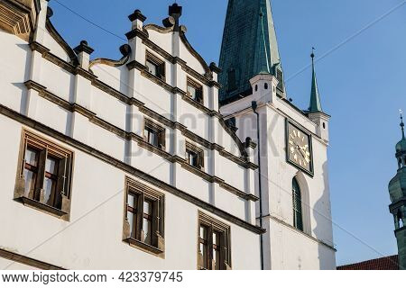 Renaissance Building Of Regional Museum, White Stone Bell Tower With Clock Near All Saints Church On