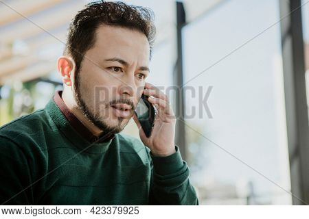 Stressful man speaking on the phone