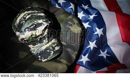 American Flag And Military Hat Or Bag. Top View Angle.