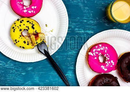 Sweet Donuts On A Plate. Colored Donuts. Sweets. Donuts At A Childrens Party.
