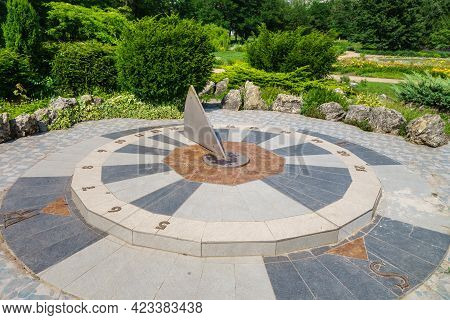 Ancient Sundial Showing Exact Time And Sides Of The World. Dial Is Surrounded By Ornament Of Stones