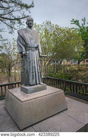 Fukuyama, Japan - 05.20.2019: Statue Of Abe Masahiro In The Garden Below Fukuyama Castle On A Grey,