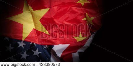 Usa And China Flag On Black Background.