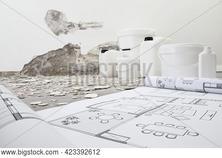 House Renovation And Plan Concept. Blue Print Project Draw. Buckets And Jerry Can Products For Paint