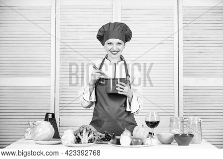 Happy Woman Cooking Healthy Food By Recipe. Restaurant Menu. Dieting. Woman In Cook Hat And Apron. P