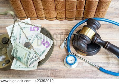 Law Gavel And Balance Weighter With Money, Treatment Costs And Medical Law Concept