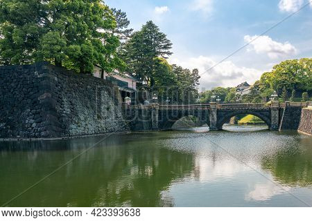 Tokyo, Japan - 12.05.2019: Water Canal And Stone Wall Of Emperor Palace Complex In Capital Of Japan