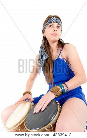 Happy young pretty woman playing drum