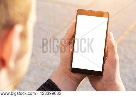 Mobile Phone Outdoor, Close Up. Mockup Image Blank White Screen Cell Phone. Men Hand Holding Texting