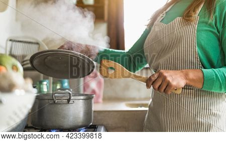 Latin Mature Woman Cooking In Old Vintage Kitchen - Mother Preparing Lunch For The Family At Home -