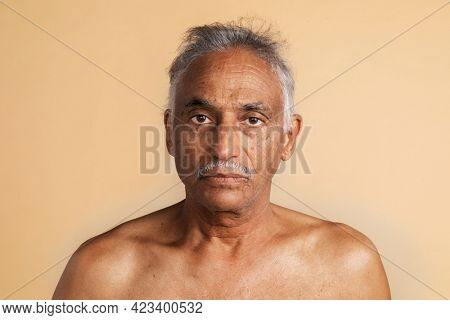 Bare chested mixed senior Indian man