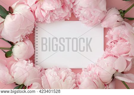 Notepad And Pink Peony Flower On Pink Background, Concept For Summer Plans, Wish List, Shopping, Bla