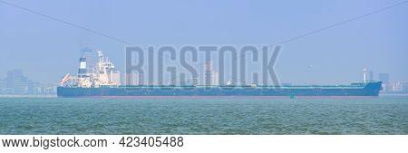 Massive Freight Ship Sailing Near Berskens And Vlissingen, Zeeland, The Netherlands
