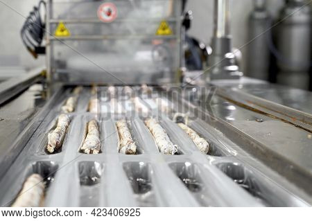 Sausages. Packing Line Of Sausages Fuet Is A Catalan Thin, Cured, Dry Sausage Of Pork Meat In A Pork