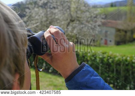 Boy Watching The View With Binocular. Hands Holding Binocular Close-up. Travel, Tourism. Future Plan
