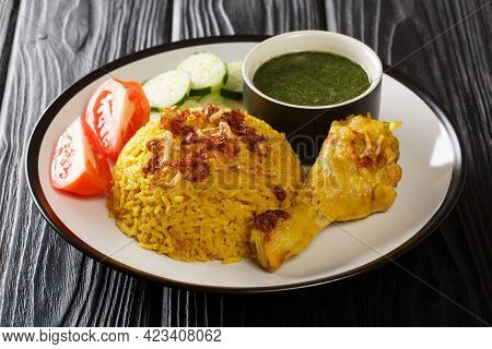Asian Chicken Biryani Recipe Khao Mok Gai With Dipping Sauce Closeup In The Plate On The Table. Hori