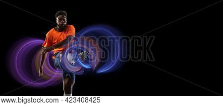 Young African Football, Soccer Player In Neon Light On Black Background. Concept Of Motion And Actio