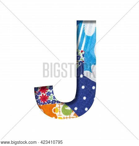 Handicraft Or Creative Font. The Letter J Cut Out Of Paper On The Background Of The Texture Of Piece