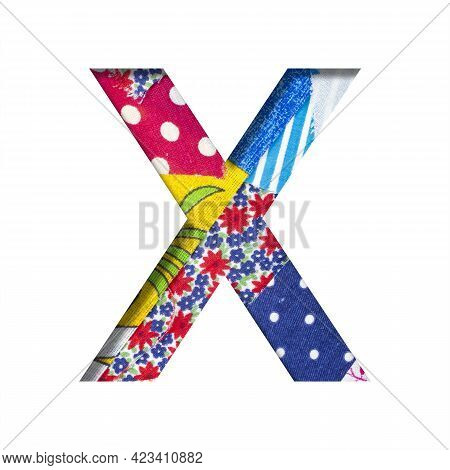 Handicraft Or Creative Font. The Letter X Cut Out Of Paper On The Background Of The Texture Of Piece