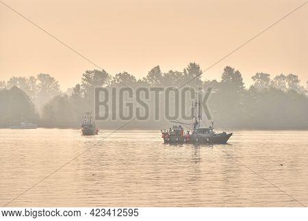 Richmond, British Columbia, Canada - August 15, 2018. Gillnetter Fishermen With Nets Set. Gillnetter
