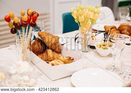 Party Catering. Festive Dinner Table Setting With Canapes, Croissants, Different Snacks For Celebrat