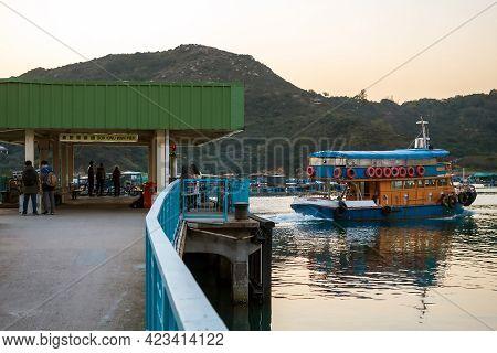 Hong Kong - January 25, 2016: Big Ferry Boat Departs From The Pier In Sok Kwu Wan Village On Lamma I