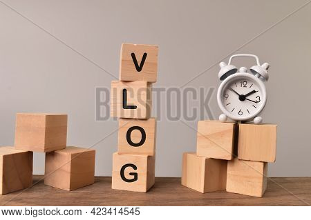 Wooden Blocks Written With Vlog. Vlog Is A Form Of Blog For Which The Medium Is Video.