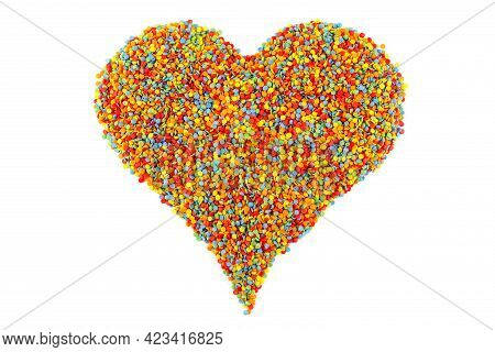 Colored Sugar Sprinkle Dots Laid In Heart Shape Isolated On White