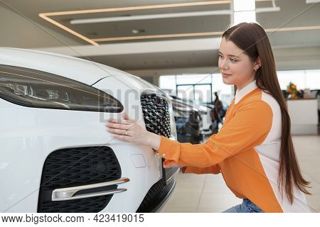Gorgeous Young Woman Choosing New Car To Buy