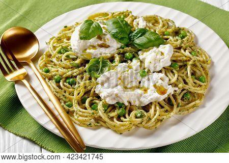 Summer Spaghetti Salad With Pesto Sauce, Green Peas, Basil Leaves And Burrata Cheese On A Plate, Ita