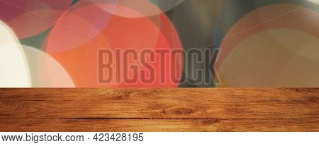 The Background Is An Empty Wooden Board And A Wall Of Blurred Bokeh Lights. For Product Demonstratio