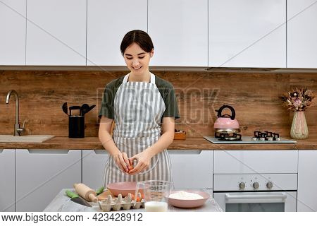 Young Beautiful Housewife Cooking On Kitchen At Home.