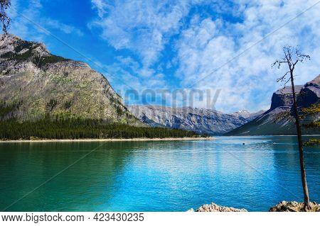 Beautiful Calm Lake Minnewanka In The Canadian Rockies Of Banff National Park, Alberta, Canada. It I