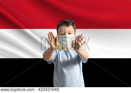 Little White Boy In A Protective Mask On The Background Of The Flag Of Egypt Makes A Stop Sign With