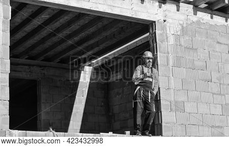 Well Done. Repairman Tired Builder Relaxing At Construction Site. Builder Smoking Cigarette. Break A