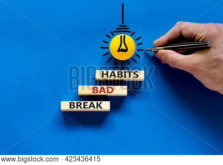 Break Bad Habits Symbol. Wooden Blocks With Words 'break Bad Habits'. Businessman Hand. Light Bulb I
