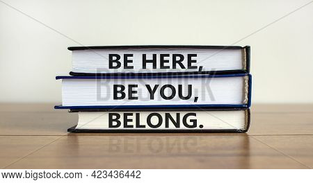Diversity, Inclusion And Belong Symbol. Books With Words 'be Here, Be You, Belong' On Beautiful Wood