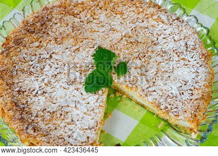 Homemade Yogurt Pie From Sprinkled Dough With Mint Leaf On A Tray